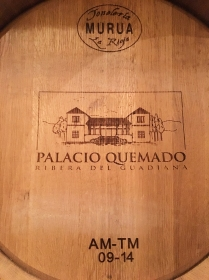 barrel end bearing the name and image of Palacio Quemado