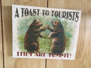 two bears toasting; caption: A TOAST TO TOURISTS. THEY ARE YUMMY!